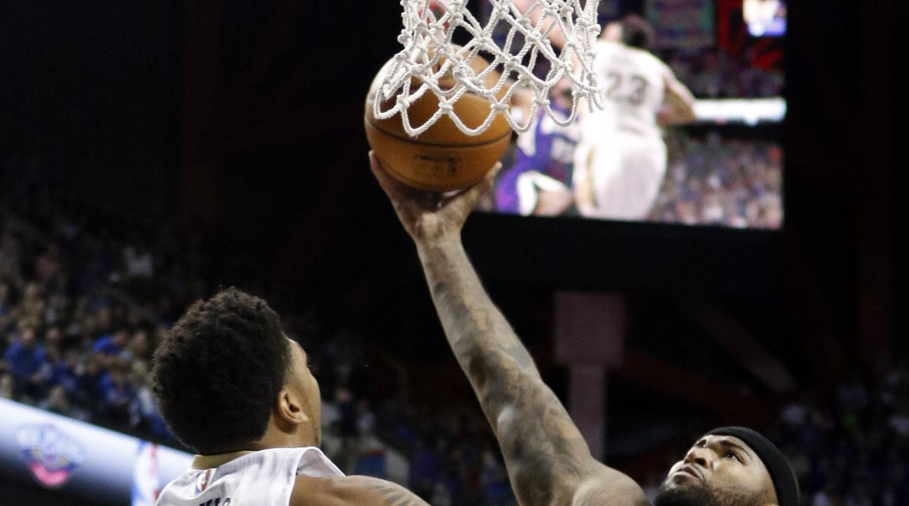 Sacramento Kings' Demarcus Cousins, right, goes up for a dunk while defended by New Orleans Pelicans' Anthony Davis during an NBA preseason basketball game, Saturday, Oct. 17, 2015, in Lexington, Ky. (AP Photo/James Crisp)