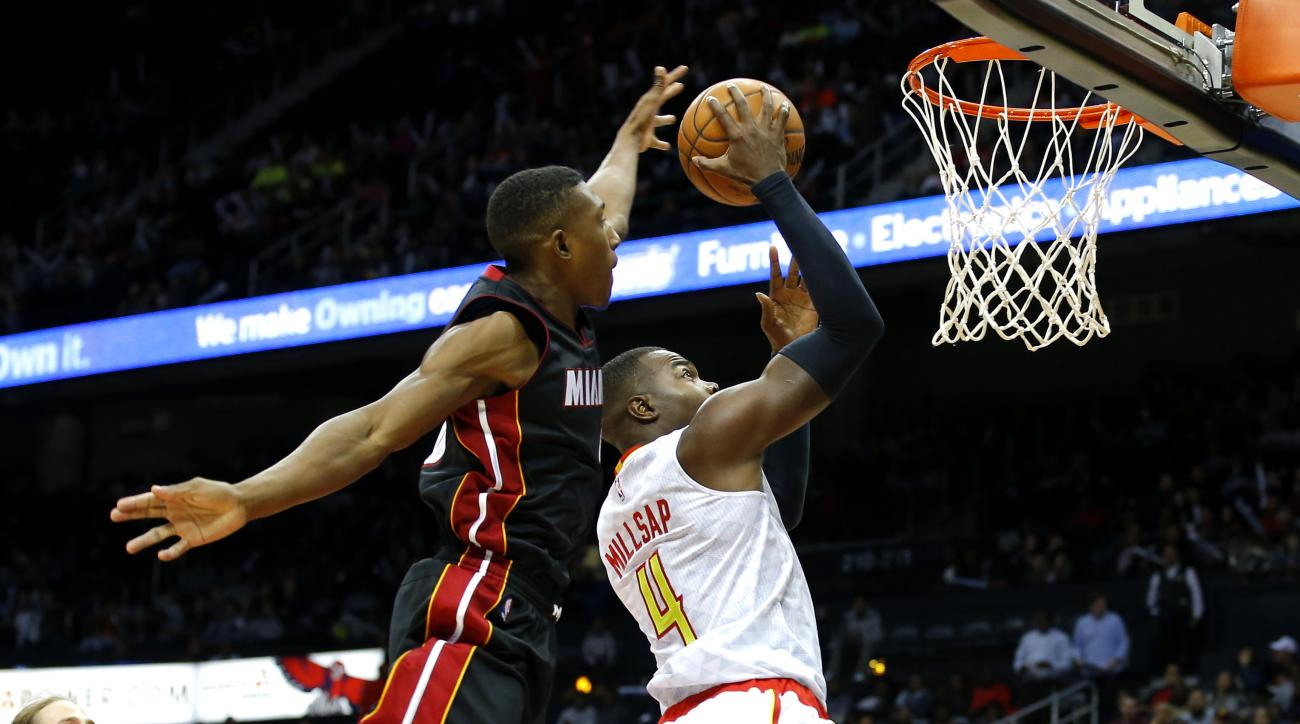 Miami Heat guard Josh Richardson (0) is called for a foul against Atlanta Hawks forward Paul Millsap (4) in the first half of a preseason NBA basketball game, Sunday, Oct. 18, 2015, in Atlanta. (AP Photo/Todd Kirkland)