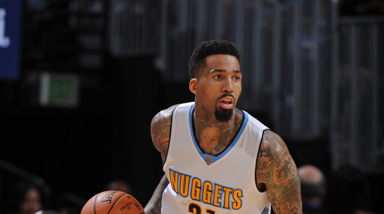 DENVER, CO - OCTOBER 16:  Wilson Chandler #21 of the Denver Nuggets dribbles the ball against the Phoenix Suns during a preseason game on October 16, 2015 at the Pepsi Center in Denver, Colorado. (Photo by Garrett Ellwood/NBAE via Getty Images)