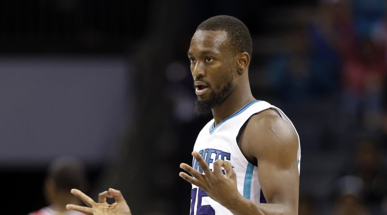 Charlotte Hornets' Kemba Walker (15) reacts after making a three-point basket against the Chicago Bulls in the second half of an NBA preseason basketball game in Charlotte, N.C., Monday, Oct. 19, 2015. The Hornets won 94-86. (AP Photo/Chuck Burton)