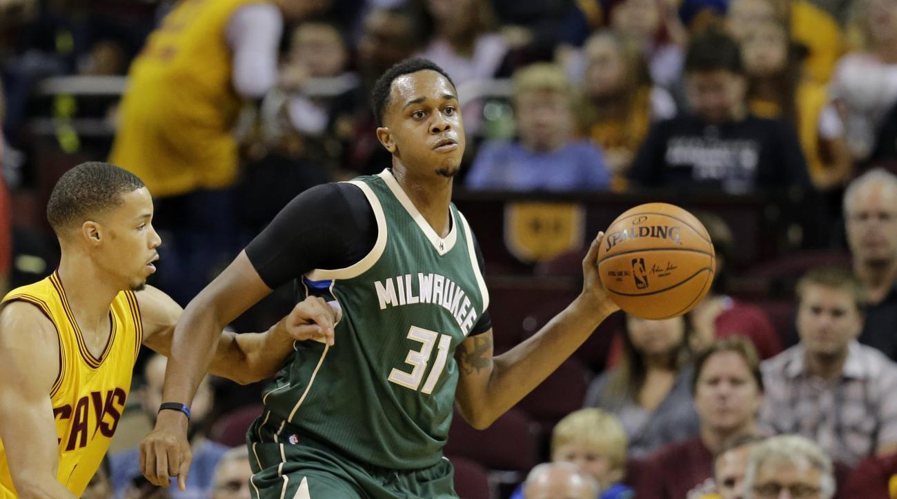 FILE- In this Oct. 13, 2015, file photo, Milwaukee Bucks' John Henson (31) passes against the Cleveland Cavaliers in the first half of an NBA basketball game in Cleveland. Henson says he was racially profiled at a Wisconsin jewelry store in an incident th