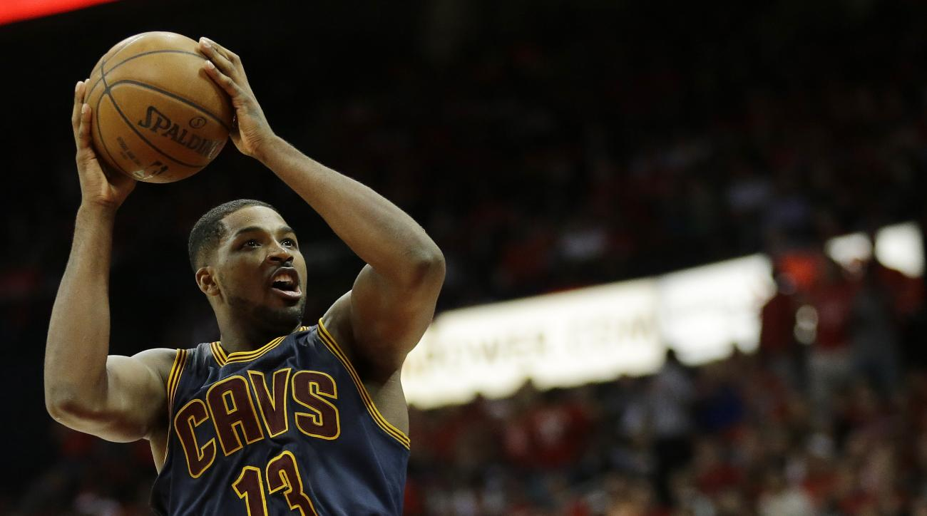 Cleveland Cavaliers center Tristan Thompson (13) shoots over Atlanta Hawks forward Paul Millsap (4) during the second half in Game 2 of the Eastern Conference finals of the NBA basketball playoffs, Friday, May 22, 2015, in Atlanta. (AP Photo/David Goldman