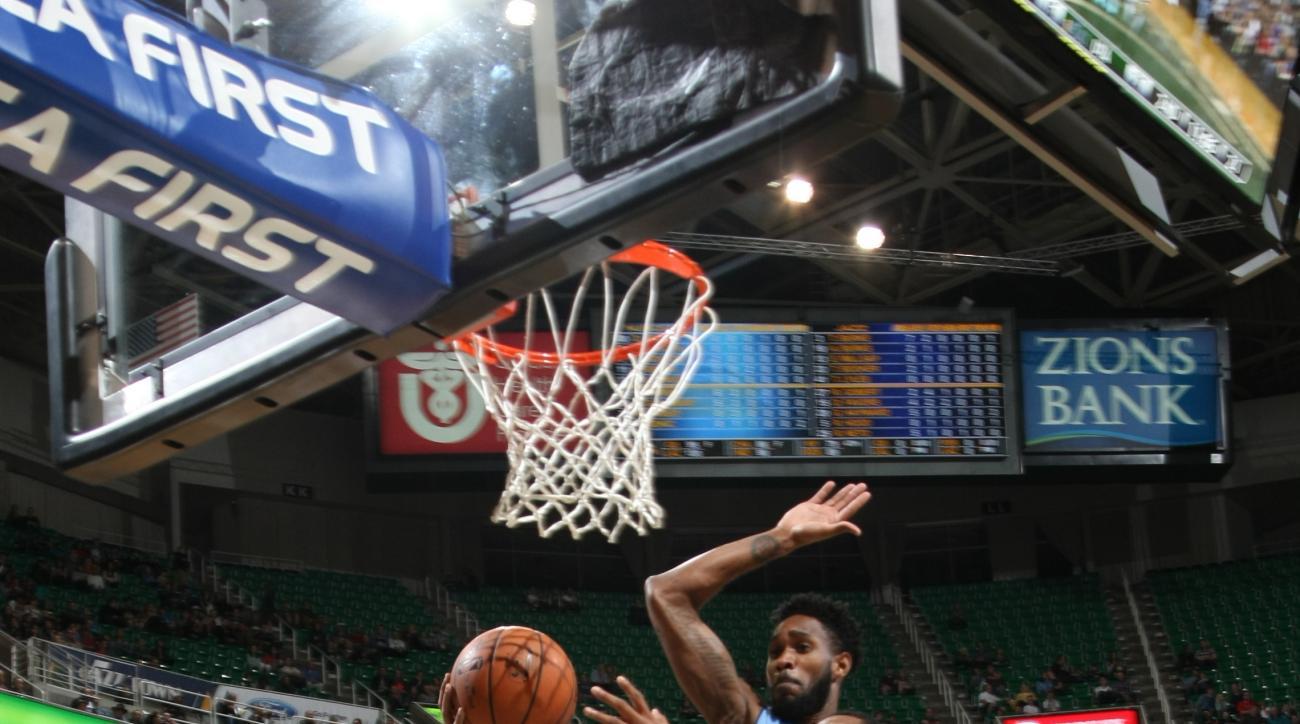 SALT LAKE CITY, UT - OCTOBER 22:  Trey Burke #3 of the Utah Jazz goes to the basket against the Denver Nuggets on October 22, 2015 at EnergySolutions Arena in Salt Lake City, Utah. (Photo by Melissa Majchrzak/NBAE via Getty Images)