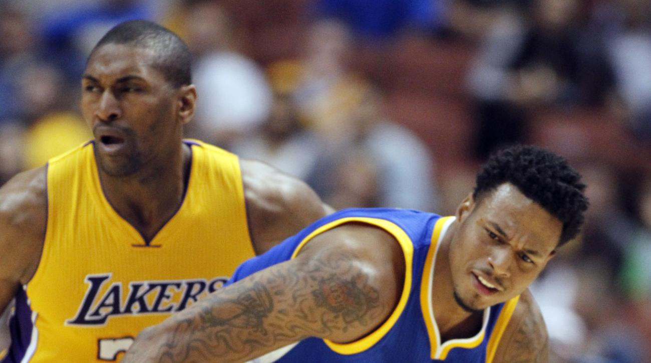 Los Angeles Lakers forward Metta World Peace, left, fouls Golden State Warriors guard Brandon Rush after knocking the ball away during the second half of an NBA preseason basketball game in Anaheim, Calif., Thursday, Oct. 22, 2015. The Warriors won 136-97