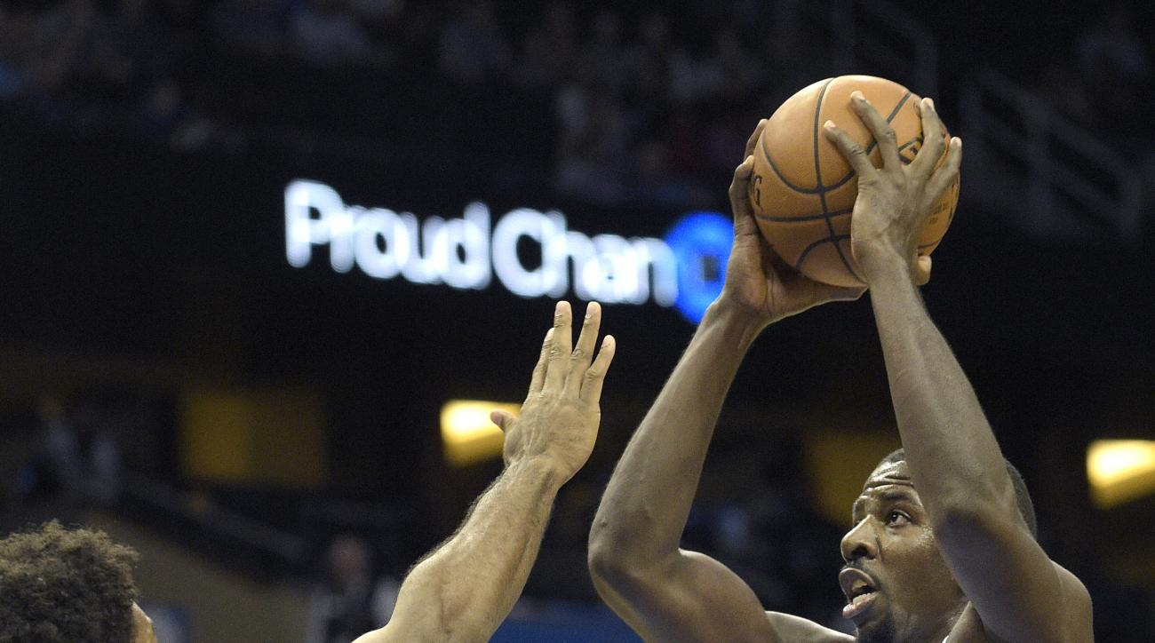 Orlando Magic forward Andrew Nicholson (44) goes up for a shot in front of Memphis Grizzlies forward Alex Stepheson (6) during the second half of a preseason NBA basketball game in Orlando, Fla., Friday, Oct. 23, 2015. The Magic won 86-76. (AP Photo/Phela