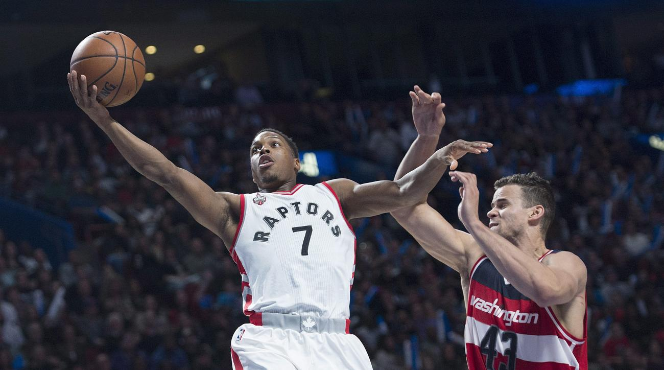 Toronto Raptors' Kyle Lowry drives to the net as Washington Wizards' Kris Humphries defends during the first half of an NBA preseason basketball game Friday, Oct. 23, 2015, in Montreal. (Graham Hughes/The Canadian Press via AP) MANDATORY CREDIT