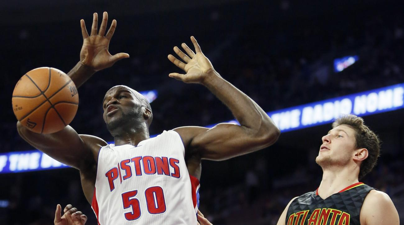 Detroit Pistons' Joel Anthony (50) dunks against Atlanta Hawks' Mike Muscala (31) during the second half of a preseason NBA basketball game Friday, Oct. 23, 2015, in Auburn Hills, Mich. The Pistons defeated the Hawks 115-87. (AP Photo/Duane Burleson)