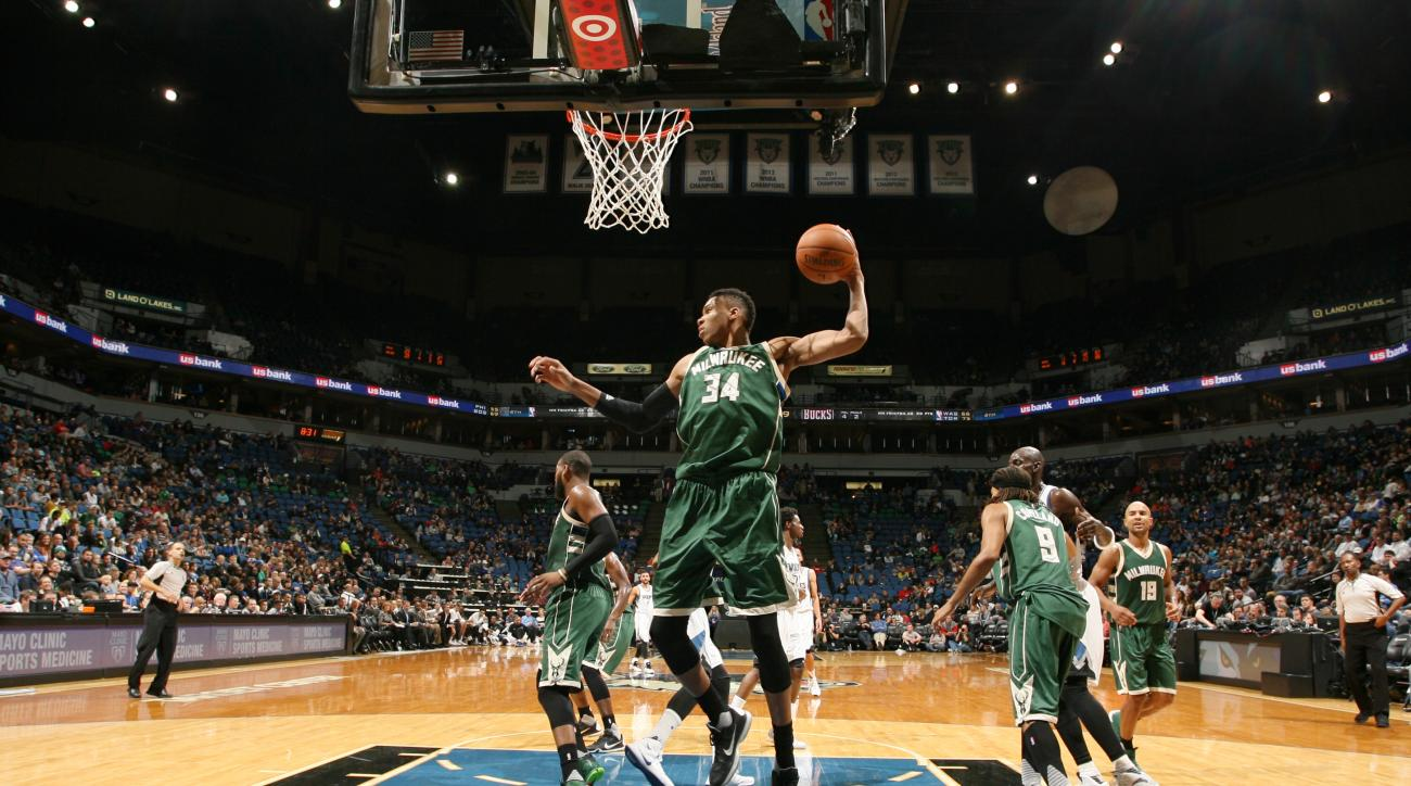 MINNEAPOLIS, MN -  OCTOBER 23:  Giannis Antetokounmpo #34 of the Milwaukee Bucks grabs the rebound against the Minnesota Timberwolves during a preseason game on October 23, 2015 at Target Center in Minneapolis, Minnesota. (Photo by David Sherman/NBAE via