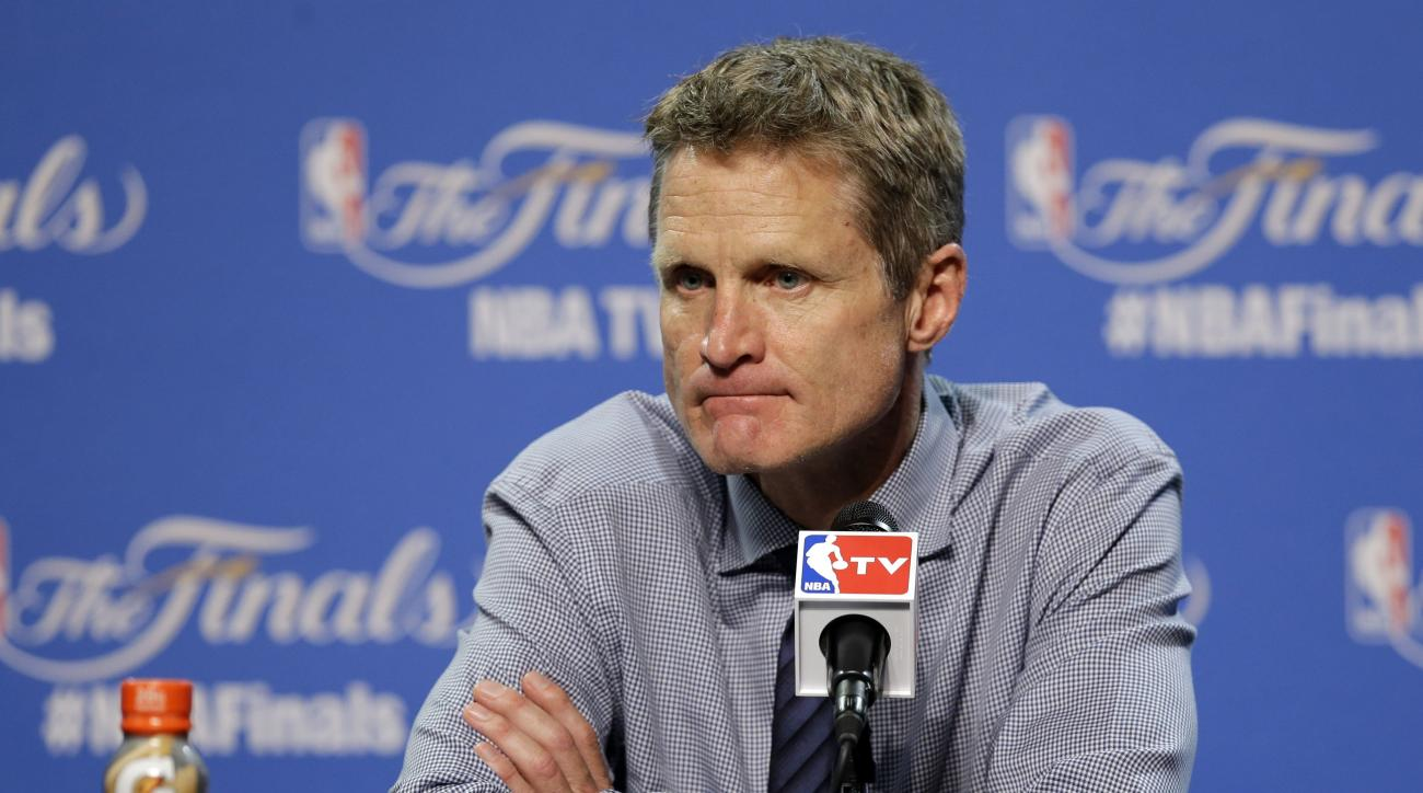 FILE - In this  Wednesday, June 10, 2015 file photo, Golden State Warriors head coach Steve Kerr listens to a question during a press conference following Game 3 of basketball's NBA Finals against the Cleveland Cavaliers in Cleveland.  Golden State Warrio