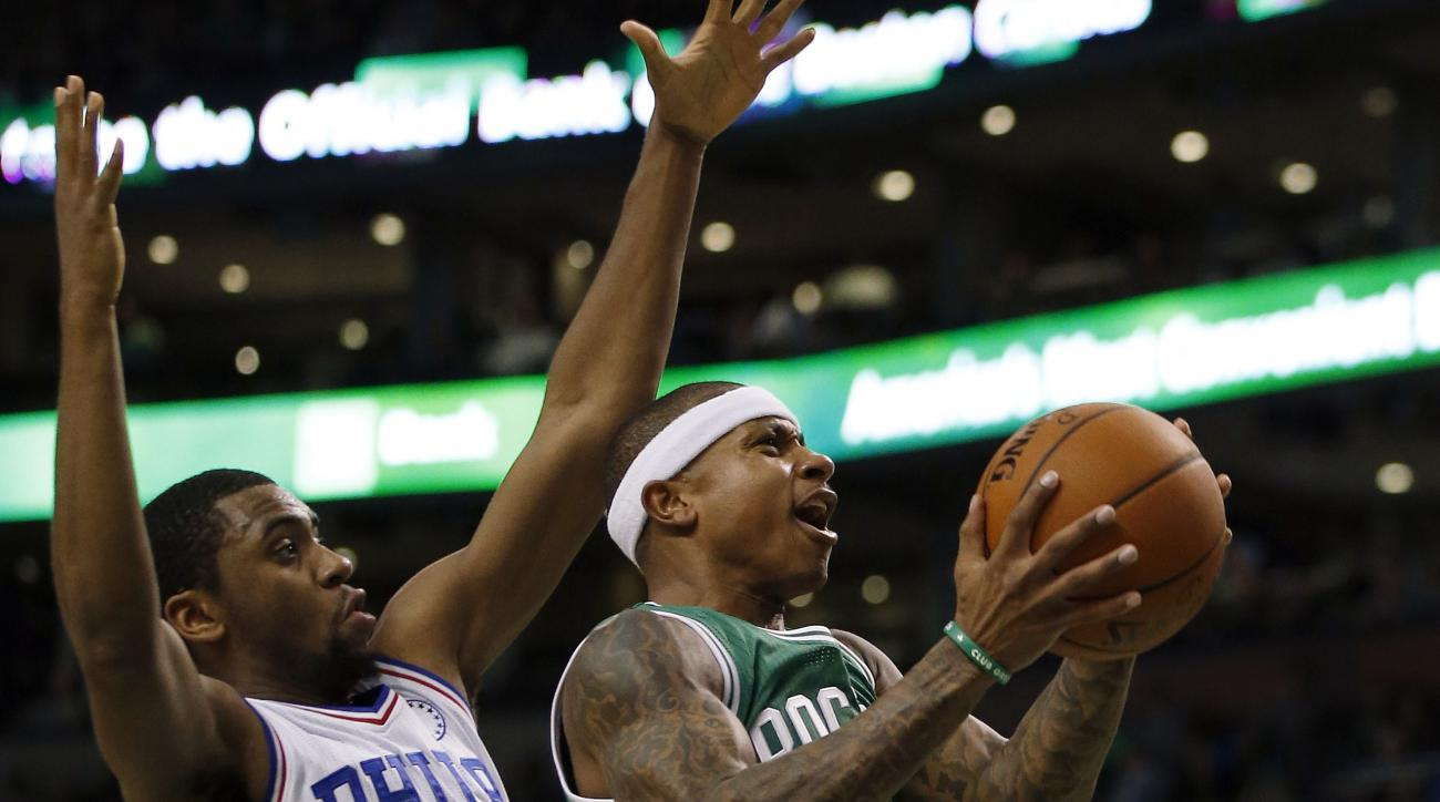 Boston Celtics' Isaiah Thomas (4) drives past Philadelphia 76ers' Hollis Thompson (31) during the second quarter of an NBA basketball game in Boston, Wednesday, Oct. 28, 2015. (AP Photo/Michael Dwyer)
