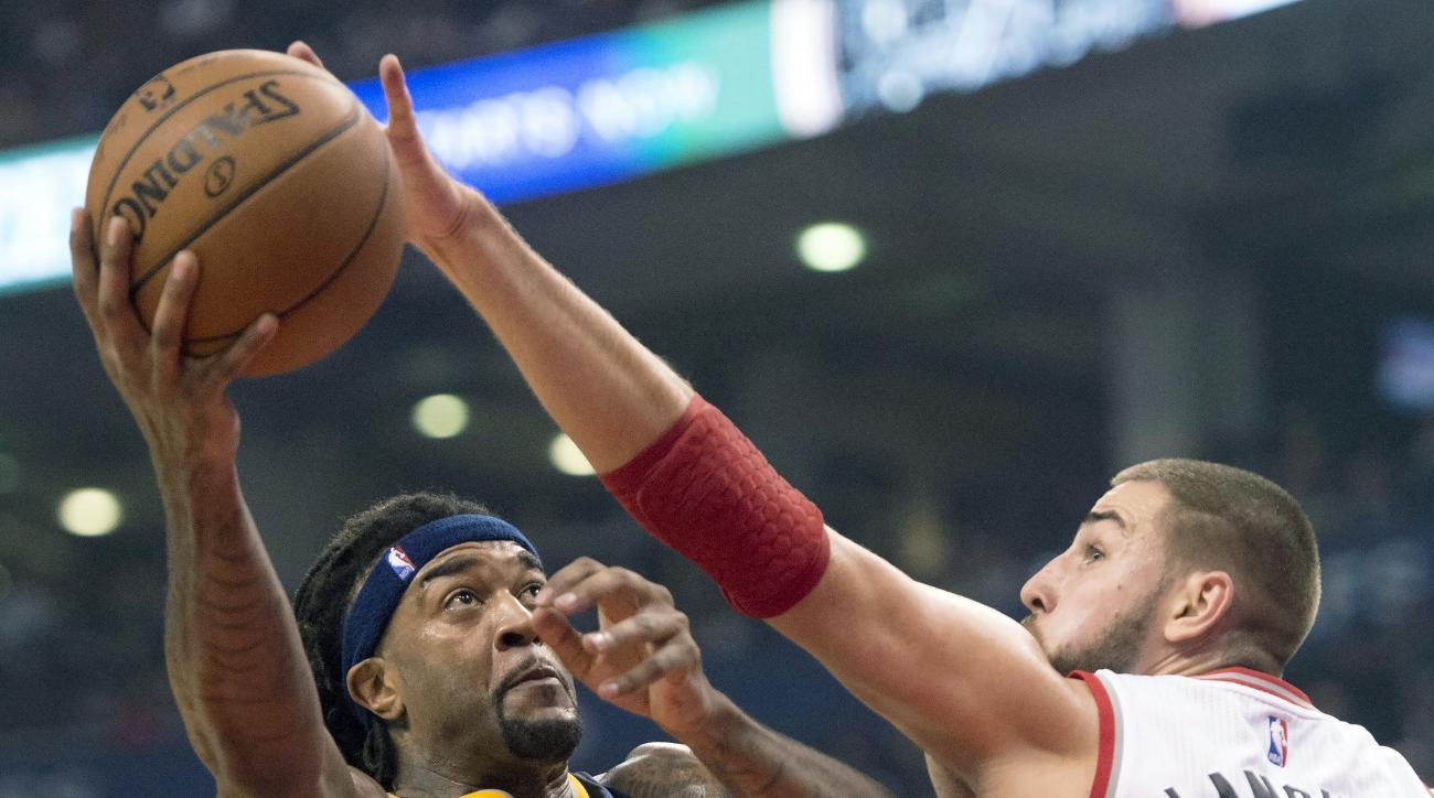 Indiana Pacers' Jordan Hill comes under pressure from Toronto Raptors' Jonas Valanciunas during first-half NBA basketball game action in Toronto, Wednesday, Oct. 28, 2015. (Frank Gunn/The Canadian Press via AP) MANDATORY CREDIT