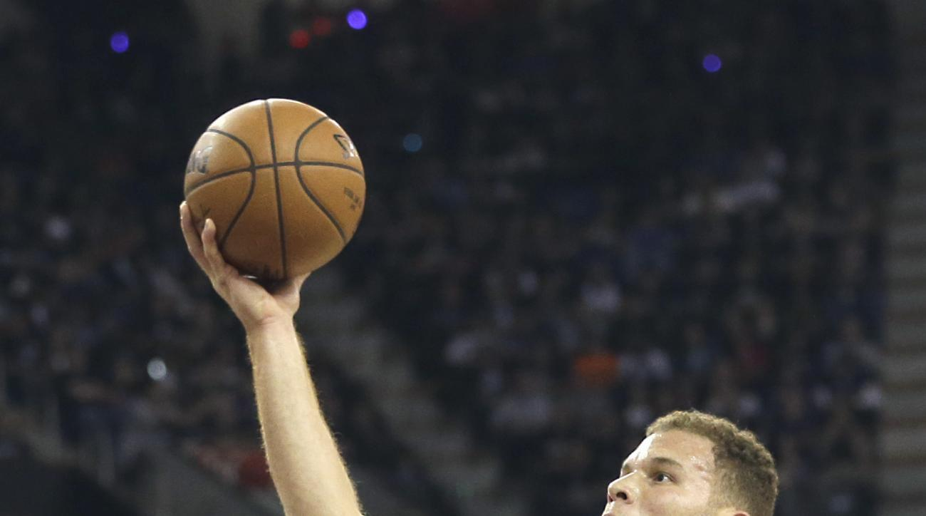 Los Angeles Clippers forward Blake Griffin, right, drives to the basket against Sacramento Kings center DeMarcus Cousins during the first quarter of an NBA basketball game in Sacramento, Calif., Wednesday, Oct. 28, 2015. (AP Photo/Rich Pedroncelli)