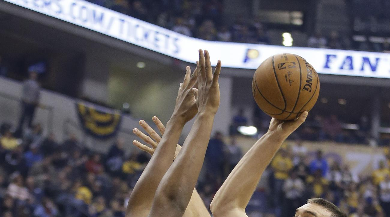 Memphis Grizzlies' Marc Gasol, right, shoots over Indiana Pacers' Myles Turner, left, during the first half of an NBA basketball game Thursday, Oct. 29, 2015, in Indianapolis. (AP Photo/Darron Cummings)