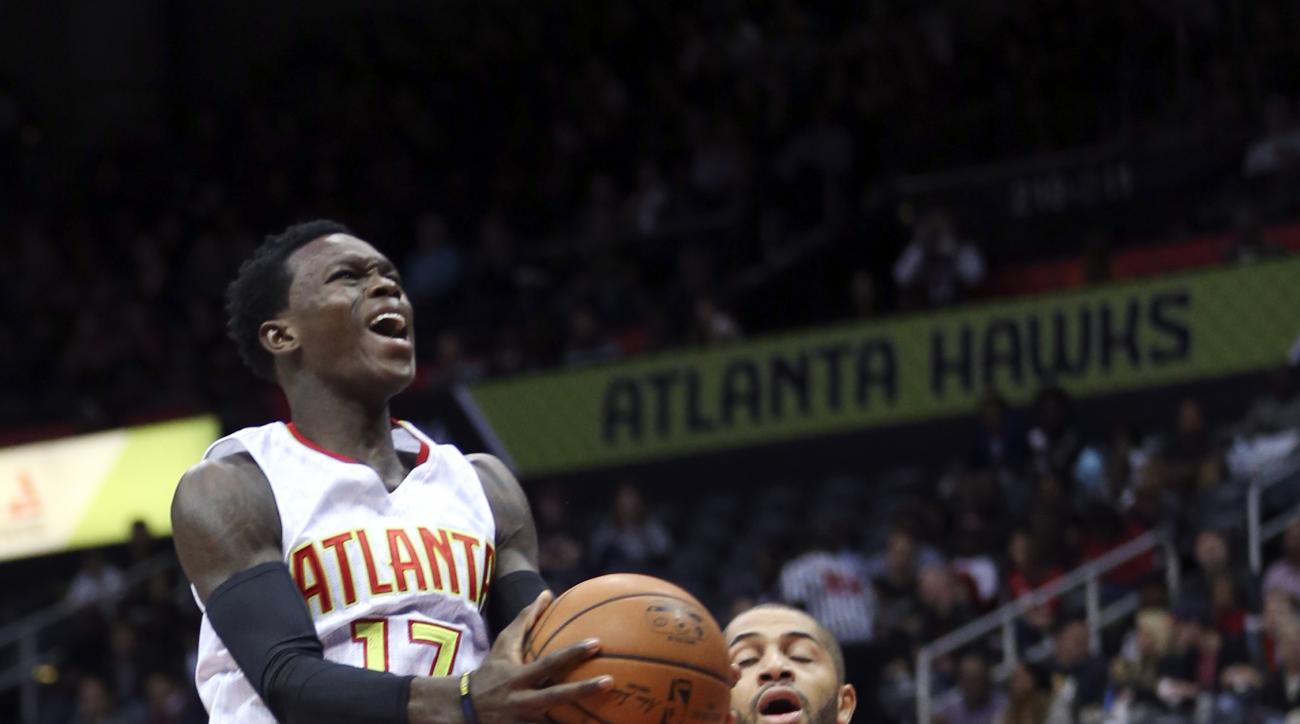Atlanta Hawks guard Dennis Schroder (17) drives past Charlotte Hornets forward Nicolas Batum (5) in the first half of an NBA basketball game  Friday, Oct. 30, 2015, in Atlanta. (AP Photo/ John Bazemore)