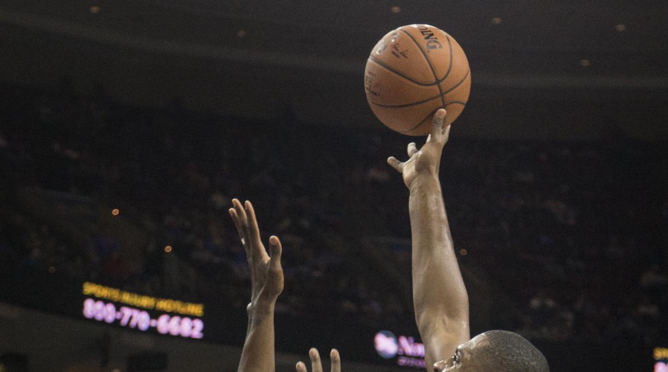 Utah Jazz forward Derrick Favors (15) shots over Philadelphia 76ers' Jerami Grant (39) in the second half of an NBA basketball game, Friday, Oct. 30, 2015, in Philadelphia. The Utah Jazz won 99-71. (AP Photo/Laurence Kesterson)