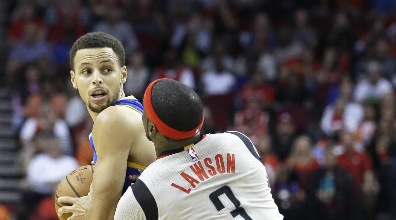 Golden State Warriors' Stephen Curry, left,  is pressured by Houston Rockets' Ty Lawson, right,  in the first half of a NBA basketball game Friday, Oct. 30, 2015, in Houston. (AP Photo/Pat Sullivan)