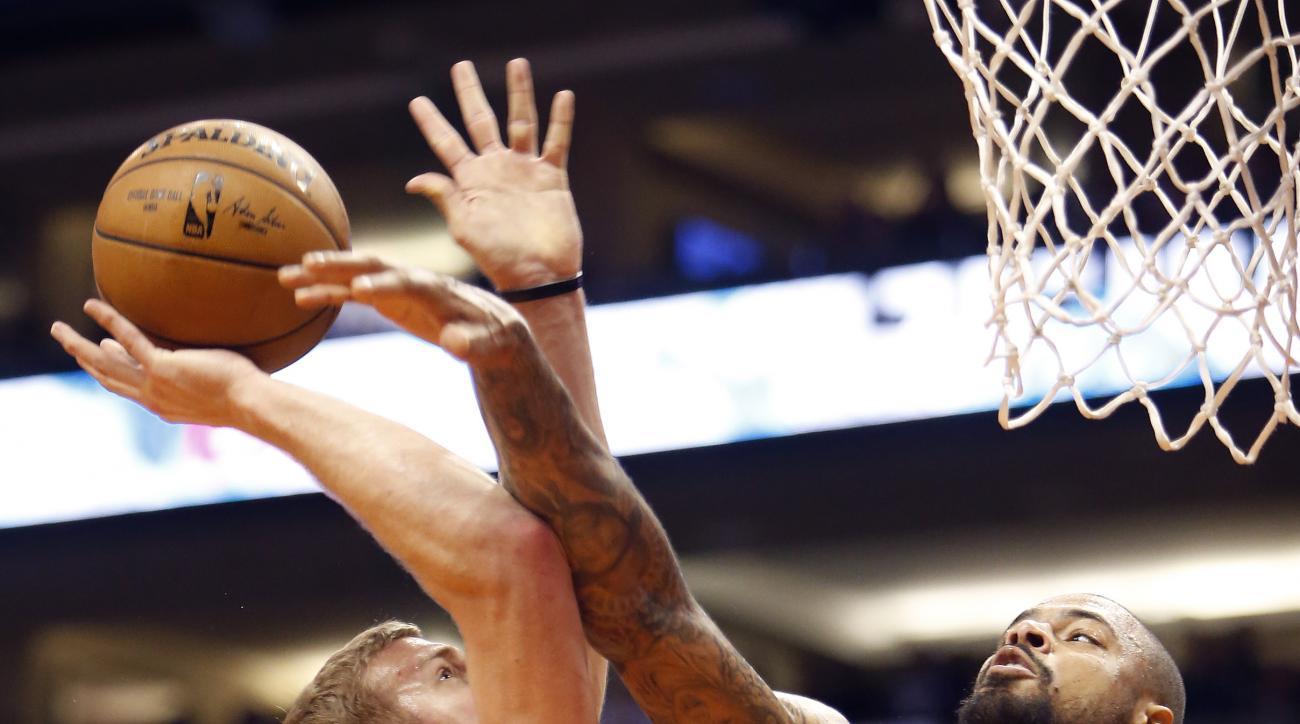 Phoenix Suns center Tyson Chandler, right, blocks the shot on Portland Trail Blazers forward Mason Plumlee in the first quarter during an NBA basketball game, Friday, Oct. 30, 2015, in Phoenix. (AP Photo/Rick Scuteri)