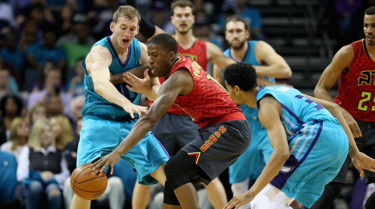 CHARLOTTE, NC - NOVEMBER 01:  Cody Zeller #40 of the Charlotte Hornets tries to steal the ball from Lamar Patterson #13 of the Atlanta Hawks during their game at Time Warner Cable Arena on November 1, 2015 in Charlotte, North Carolina. (Photo by Streeter
