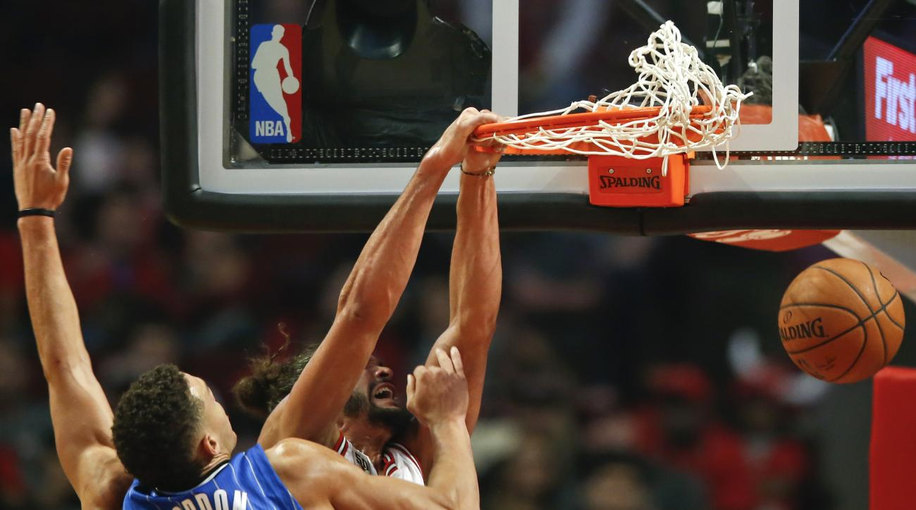 Chicago Bulls center Joakim Noah, back, scores against Orlando Magic forward Aaron Gordon, front, during the first half of an NBA basketball game, Sunday, Nov. 1, 2015, in Chicago. (AP Photo/Kamil Krzaczynski)