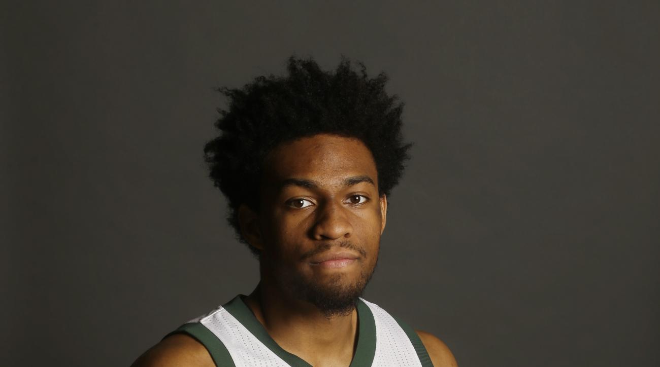 Milwaukee Bucks' Jabari Parker poses for a picture during the team's NBA basketball media day Monday, Sept. 28, 2015, in St. Francis, Wis. (AP Photo/Morry Gash)