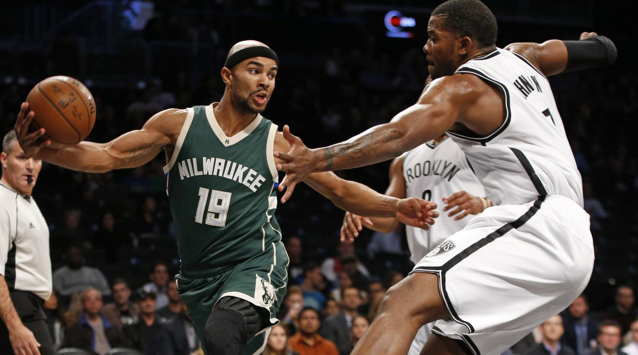 Milwaukee Bucks guard Jerryd Bayless (19) looks to pass around Brooklyn Nets forward Joe Johnson, right, in the first half of an NBA basketball game Monday, Nov. 2, 2015, in New York. (AP Photo/Kathy Willens)