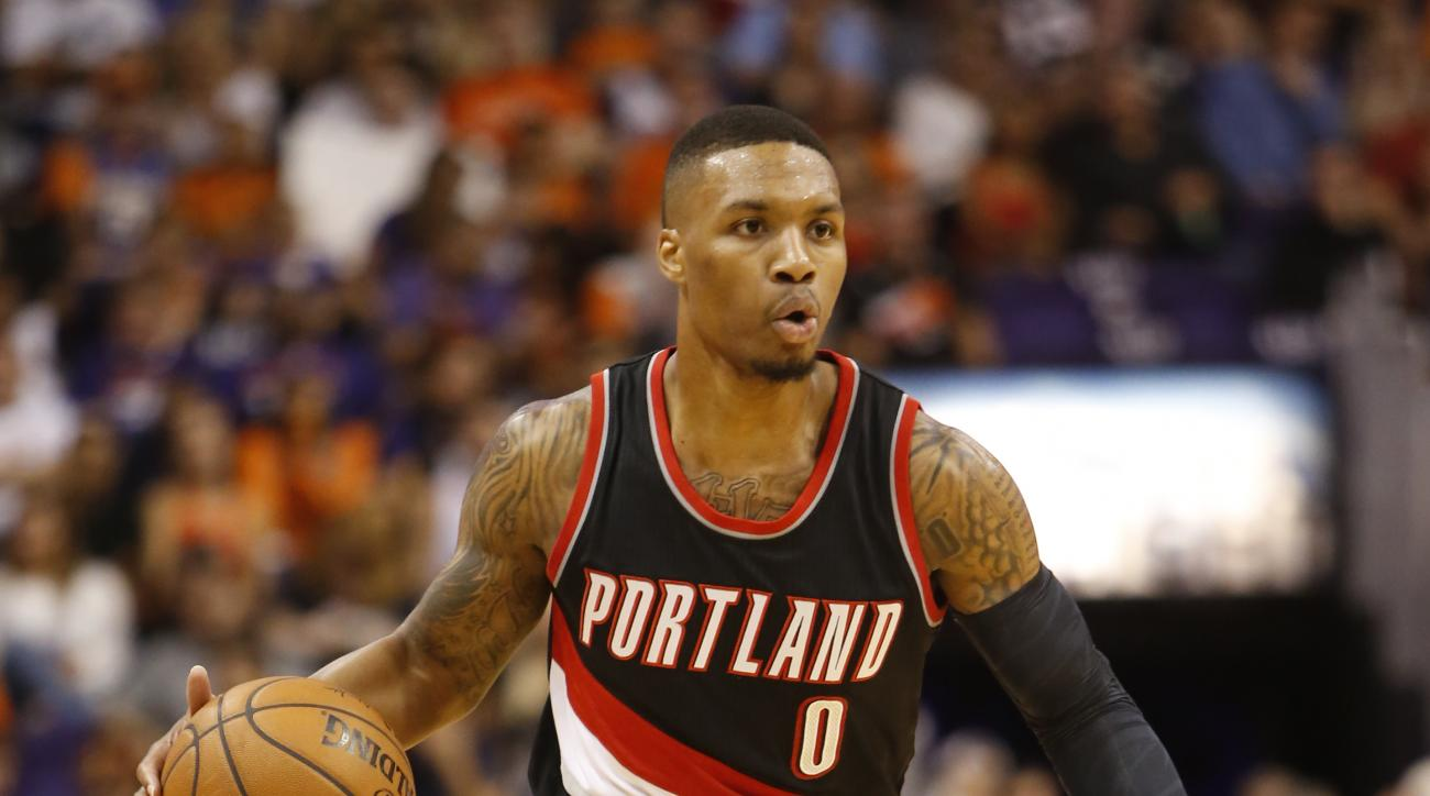 Portland Trail Blazers guard Damian Lillard (0) against the Phoenix Suns in the first quarter during an NBA basketball game, Friday, Oct. 30, 2015, in Phoenix. (AP Photo/Rick Scuteri)