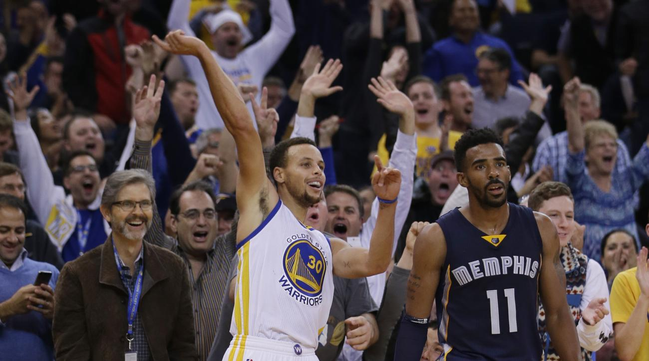 Golden State Warriors' Stephen Curry (30) celebrates after making a three-point basket next to Memphis Grizzlies' Mike Conley (11) during the second half of an NBA basketball game Monday, Nov. 2, 2015, in Oakland, Calif. (AP Photo/Marcio Jose Sanchez)