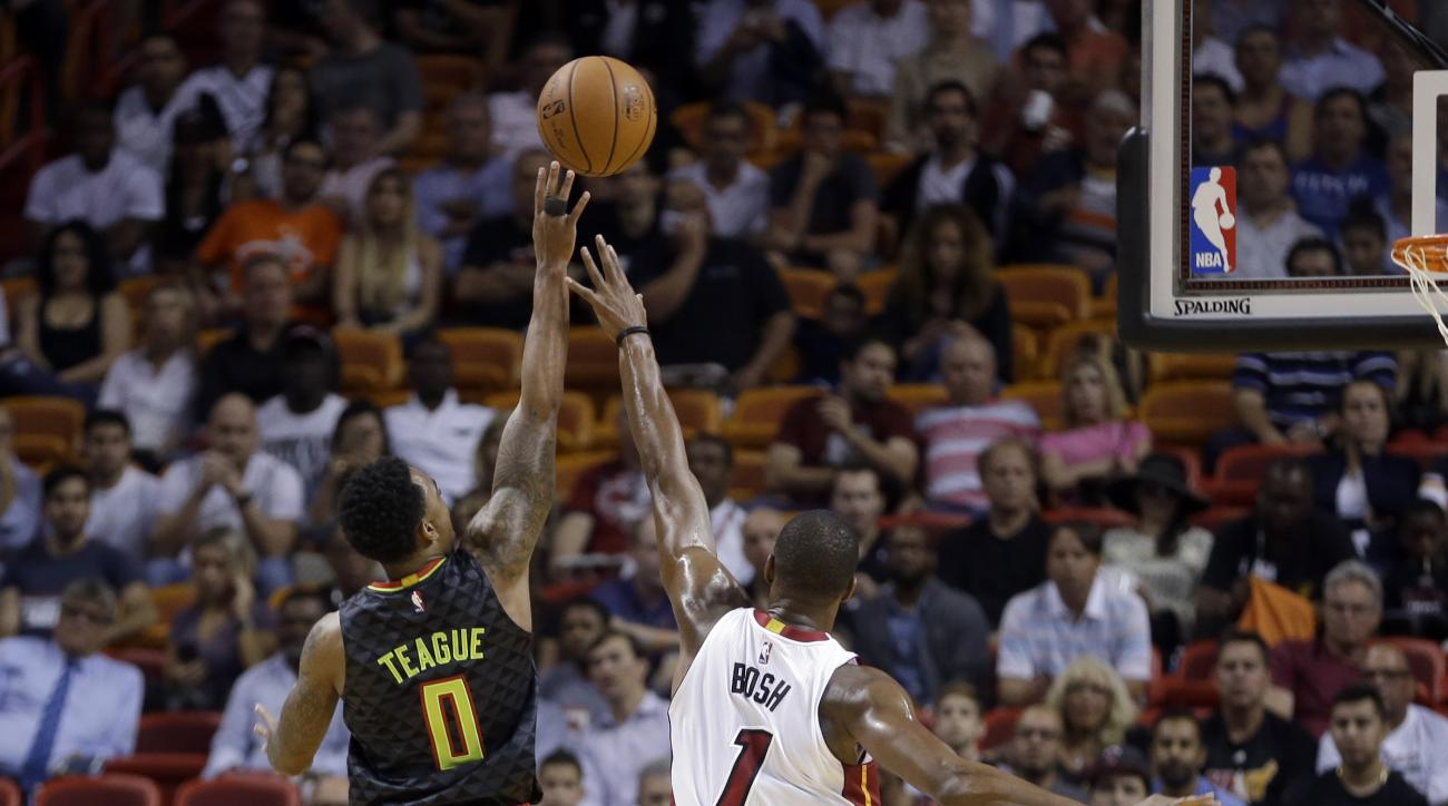 Atlanta Hawks guard Jeff Teague (0) shoots against Miami Heat forward Chris Bosh (1) during the first half of an NBA basketball game, Tuesday, Nov. 3, 2015, in Miami. (AP Photo/Alan Diaz)
