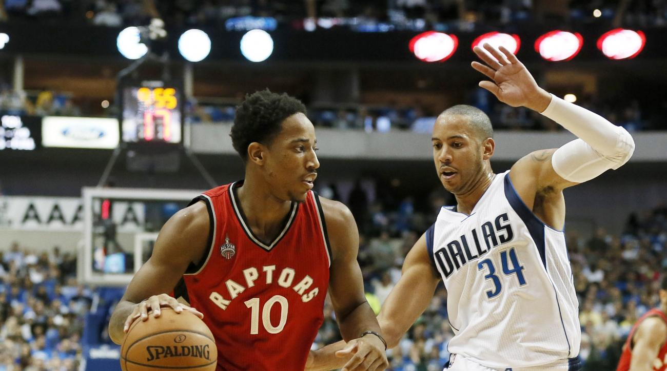 Toronto Raptors' DeMar DeRozan (10) moves the ball up court against Dallas Mavericks' Devin Harris (34) in the first half of an NBA basketball game Tuesday, Nov. 3, 2015, in Dallas.(AP Photo/Tony Gutierrez)