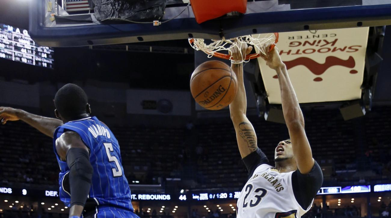 New Orleans Pelicans forward Anthony Davis (23) slam dunks over Orlando Magic guard Victor Oladipo (5) in the second half of an NBA basketball game in New Orleans, Tuesday, Nov. 3, 2015. The Magic won 103-94. (AP Photo/Gerald Herbert)