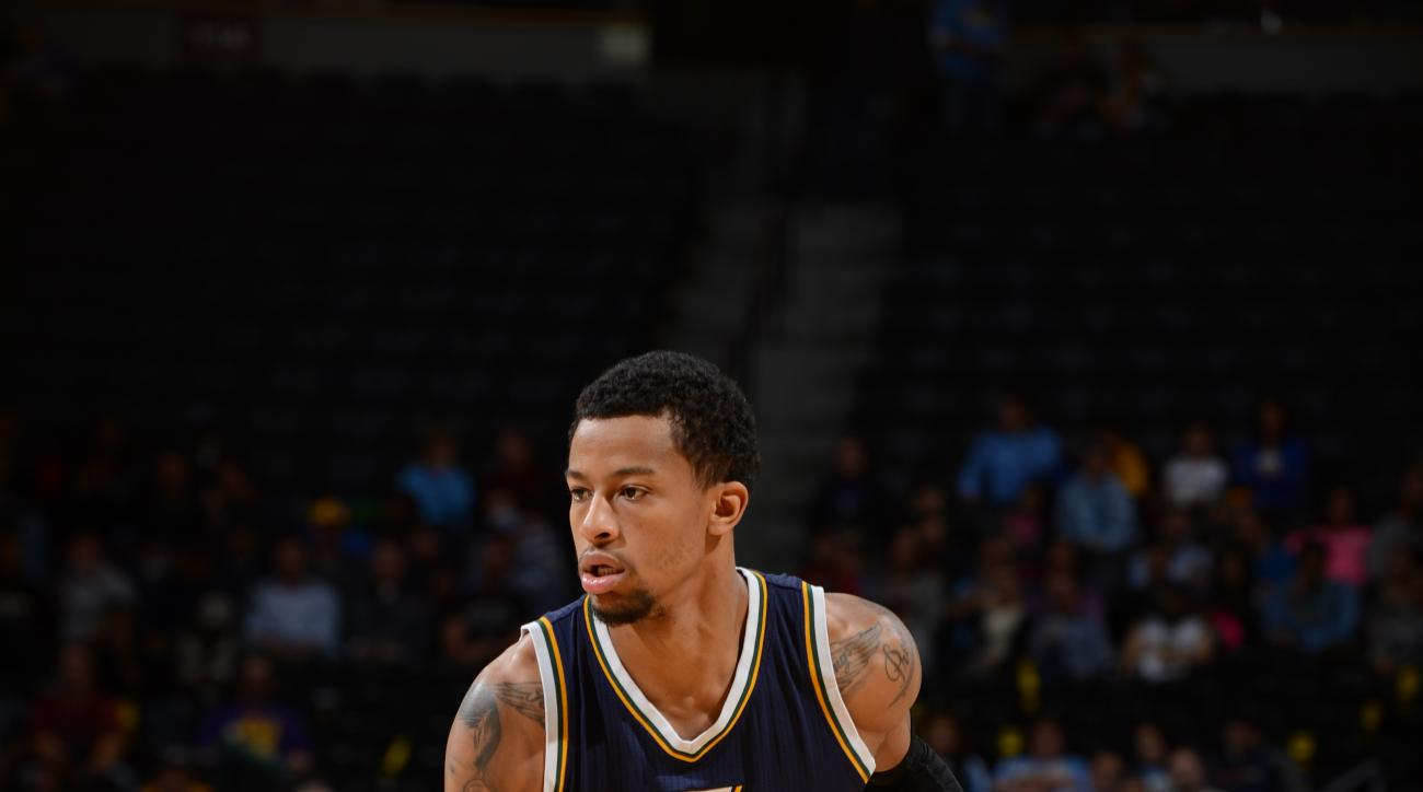 DENVER, CO - NOVEMBER 5:  Trey Burke #3 of the Utah Jazz handles the ball against the Denver Nuggets on November 5, 2015 at the Pepsi Center in Denver, Colorado. (Photo by Garrett Ellwood/NBAE via Getty Images)