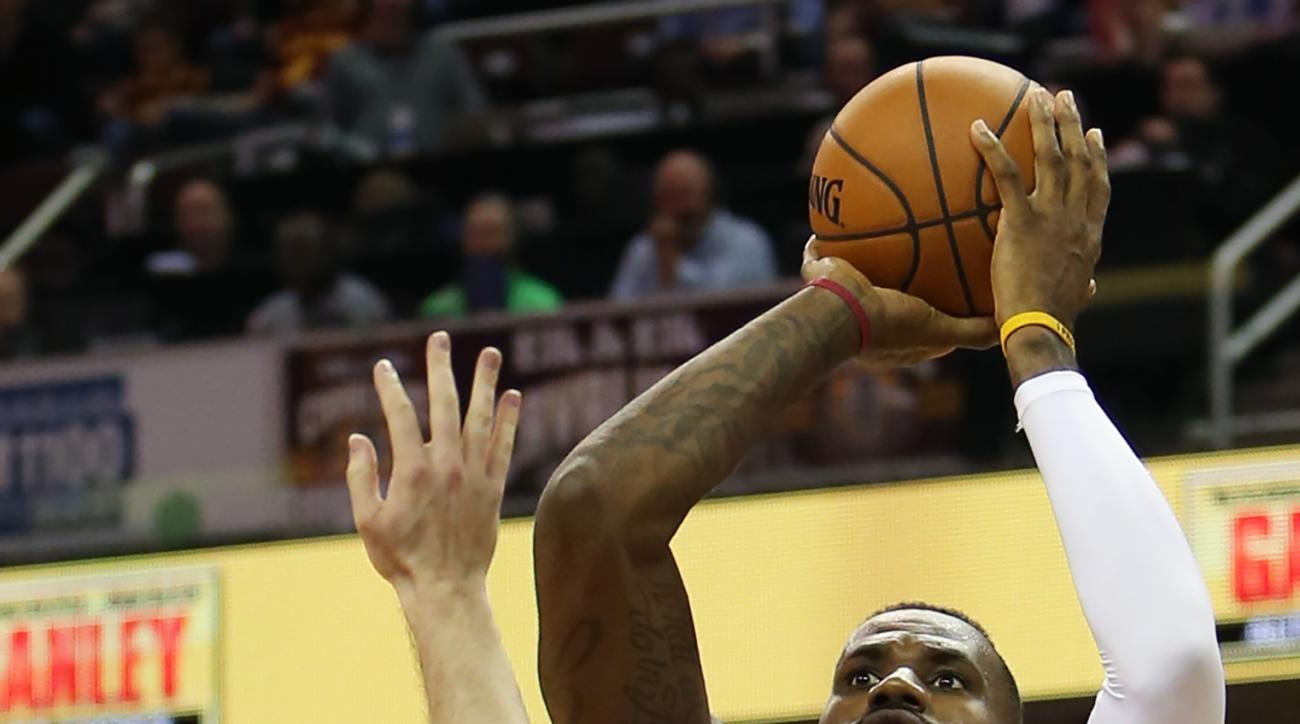 Cleveland Cavaliers forward LeBron James (23) shoots over Philadelphia 76ers guard Nik Stauskas (11) during the second half of an NBA basketball game Friday, Nov. 6, 2015, in Cleveland. The Cavaliers won 108-102. (AP Photo/Ron Schwane)