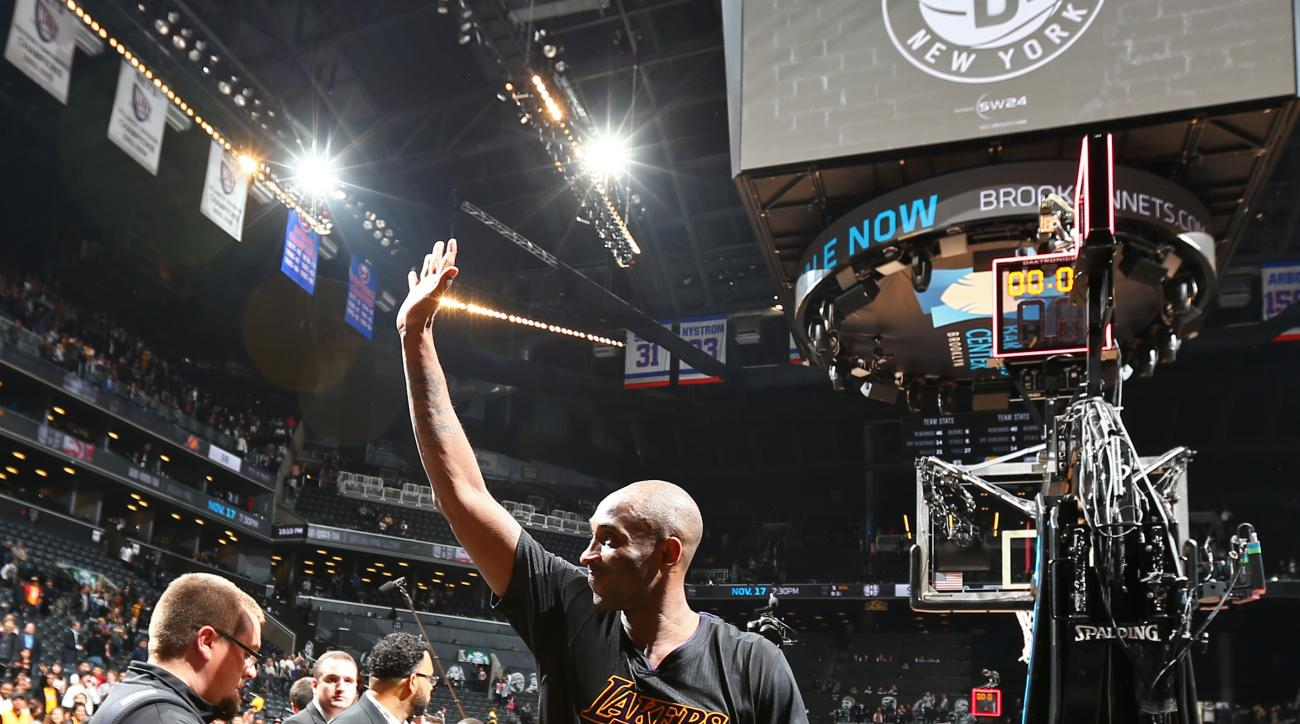 BROOKLYN, NY - NOVEMBER 06:  Kobe Bryant #24 of the Los Angeles Lakers waves to the fans as he walks off the court after the game against the Brooklyn Nets on November 6, 2015 at Barclays Center in Brooklyn, New York. (Photo by Nathaniel S. Butler/NBAE vi