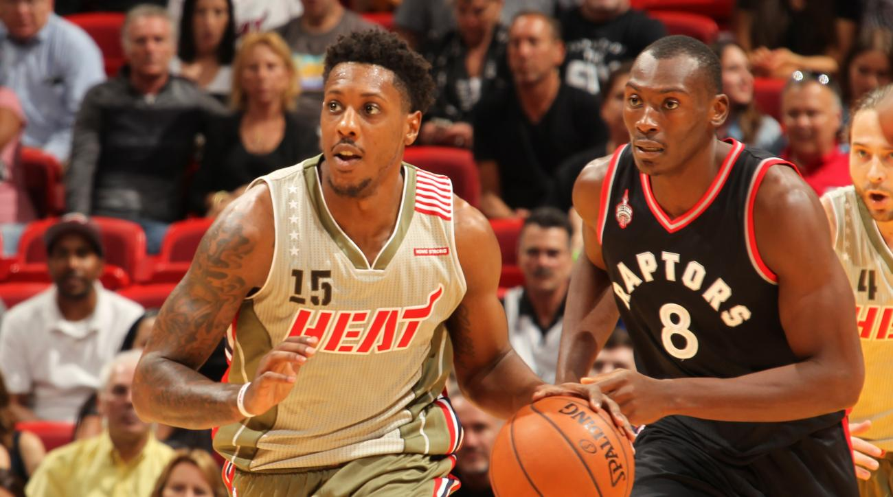 MIAMI, FL - NOVEMBER 8: Mario Chalmers #15 of the Miami Heat drives to the basket against the Toronto Raptors during the game on November 8, 2015 at American Airlines Arena in Miami, Florida. (Photo by Issac Baldizon/NBAE via Getty Images)
