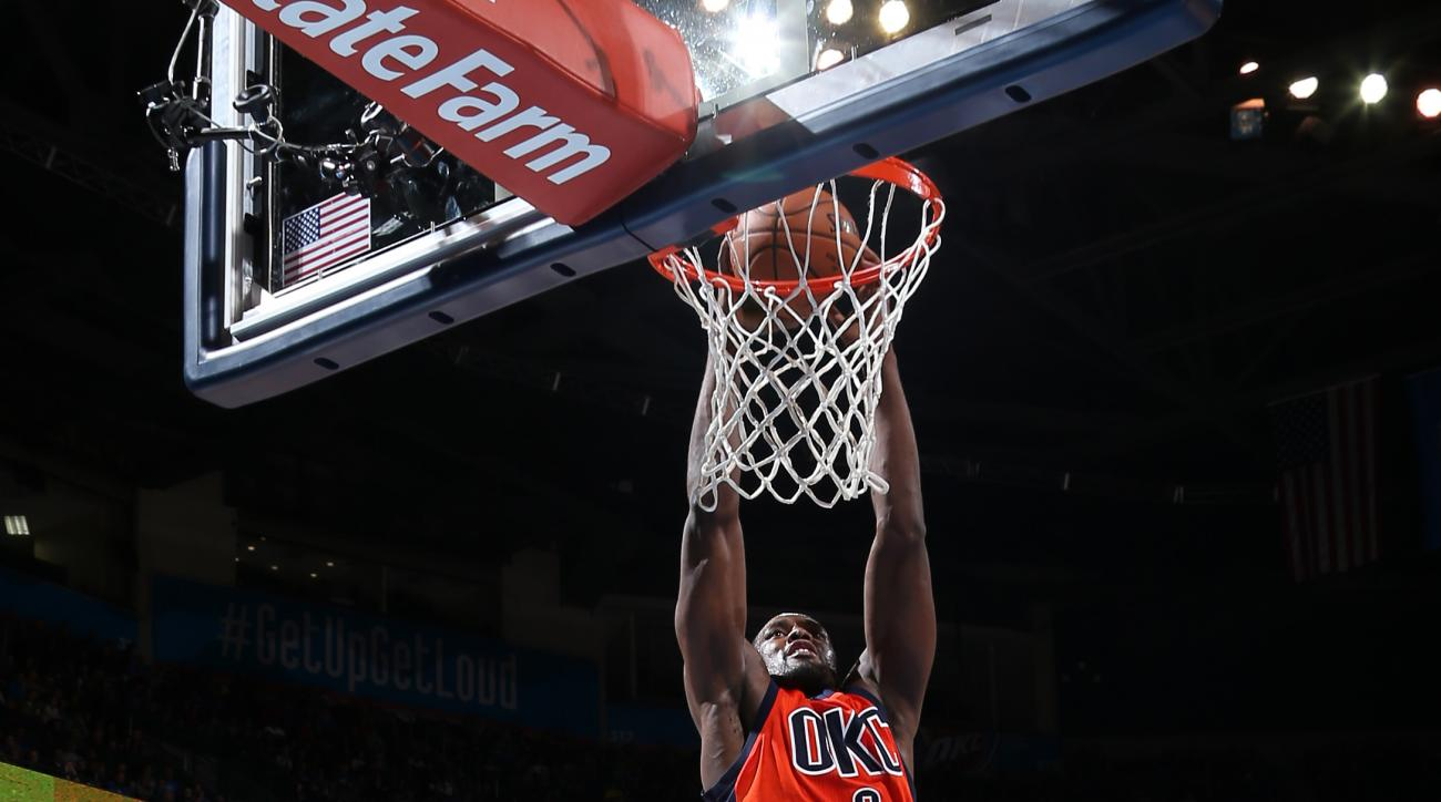 OKLAHOMA CITY, OK - NOVEMBER 8:  Serge Ibaka #9 of the Oklahoma City Thunder goes to the basket against the Phoenix Suns on November 8, 2015 at Chesapeake Energy Arena in Oklahoma City, Oklahoma. (Photo by Layne Murdoch Jr./NBAE via Getty Images)