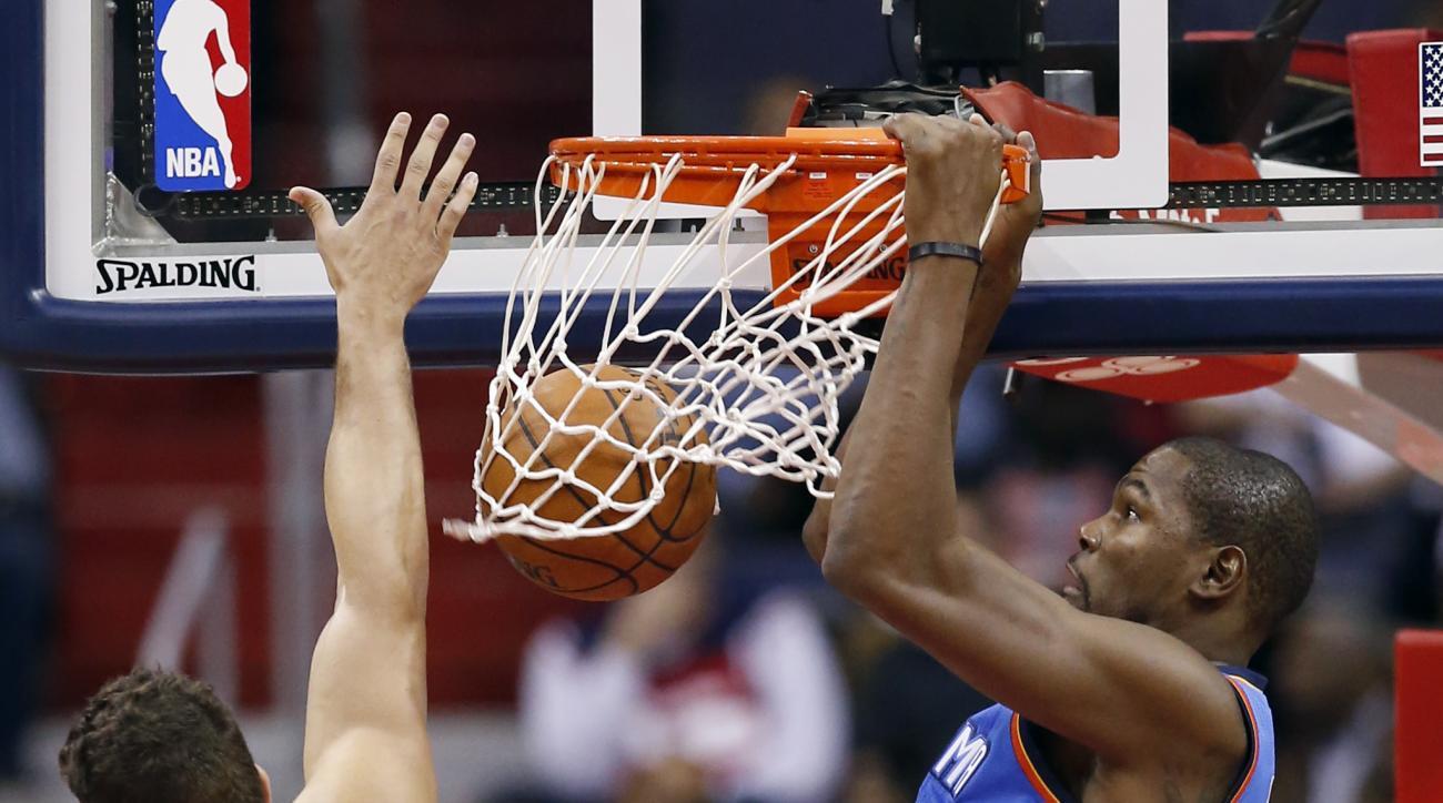 Oklahoma City Thunder forward Kevin Durant (35) dunks in front of Washington Wizards forward Kris Humphries (43) during the first half of an NBA basketball game, Tuesday, Nov. 10, 2015, in Washington. (AP Photo/Alex Brandon)