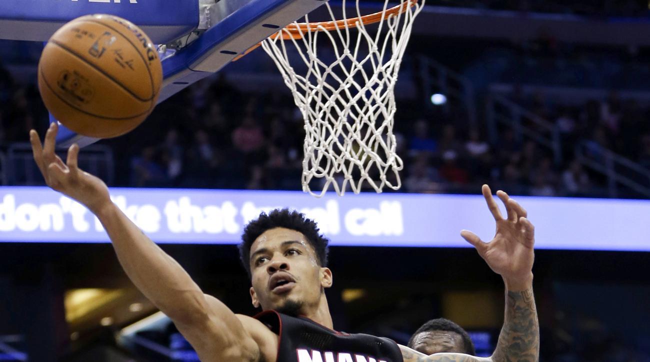 FILE - In this Oct. 13, 2015, file photo, Miami Heat guard Gerald Green goes after a rebound against the Orlando Magic during an NBA preseason basketball game in Orlando, Fla. A police report released Wednesday, Nov. 11, shows that Green had bloody hands,