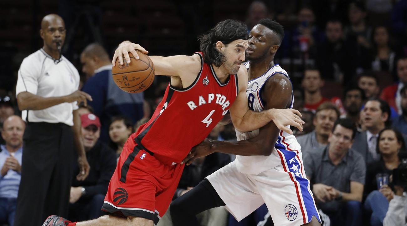 Toronto Raptors' Luis Scola, left, drives past Philadelphia 76ers' Jerami Grant during the second half of an NBA basketball game Wednesday, Nov. 11, 2015, in Philadelphia. Toronto won 119-103. (AP Photo/Matt Slocum)