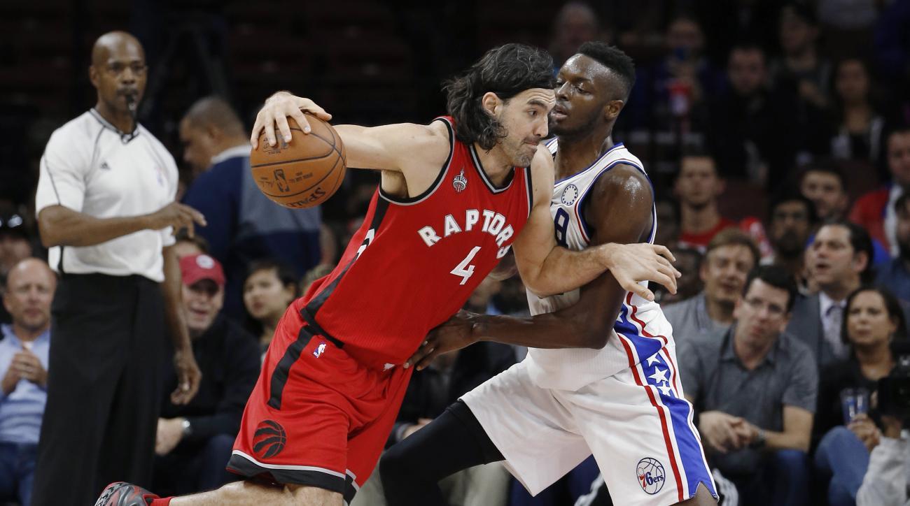 Toronto Raptors' Luis Scola, left, drives past Philadelphia 76ers' Jerami Grant during the second half of an NBA basketball game Wednesday, Nov. 11, 2015, in Philadelphia. Toronto won 119-103. (AP Photo/Matt Slocum)