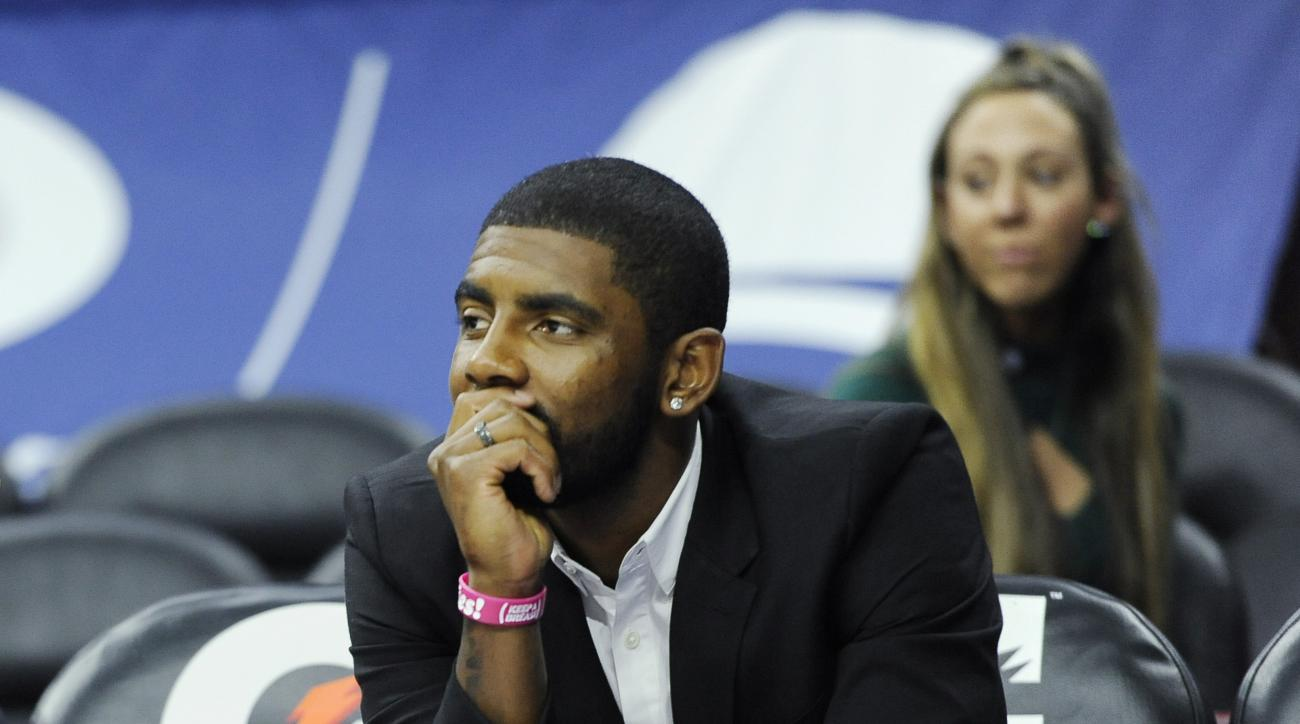 FILE - In this Nov. 2, 2015, file photo, Cleveland Cavaliers'  Kyrie Irving is shown during an NBA basketball game against the Philadlephia 76ers, in Philadelphia. By his own estimate, Kyrie Irving figures about half the people who shout at him in public