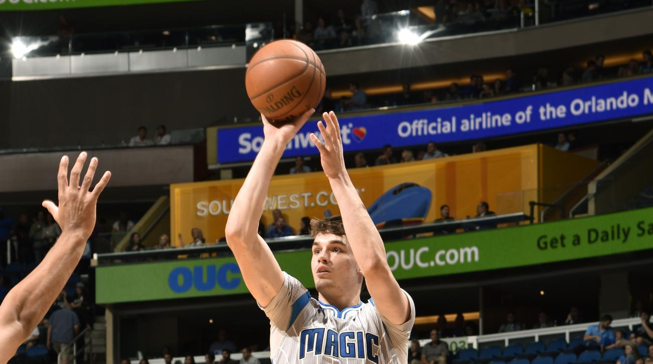 ORLANDO, FL - NOVEMBER 13: Mario Hezonja #23 of the Orlando Magic shoots against the Utah Jazz during the game on November 13, 2015 at Amway Center in Orlando, Florida. (Photo by Fernando Medina/NBAE via Getty Images)