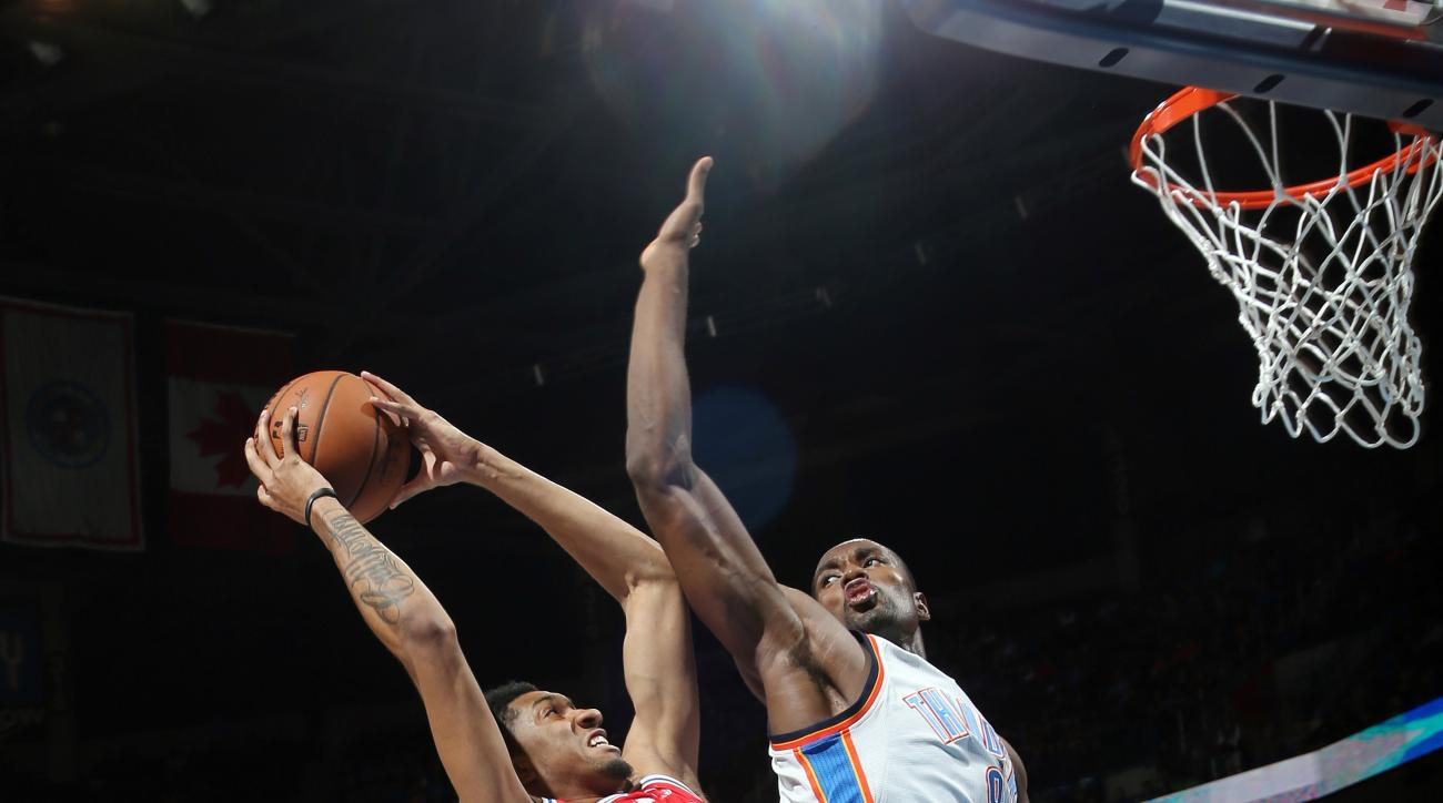 OKLAHOMA CITY, OK - NOVEMBER 13: Christian Wood #35 of the Philadelphia 76ers goes for the lay up against Serge Ibaka #9 of the Oklahoma City Thunder during the game on November 13, 2015 at Chesapeake Energy Arena in Oklahoma City, Oklahoma. (Photo by Lay