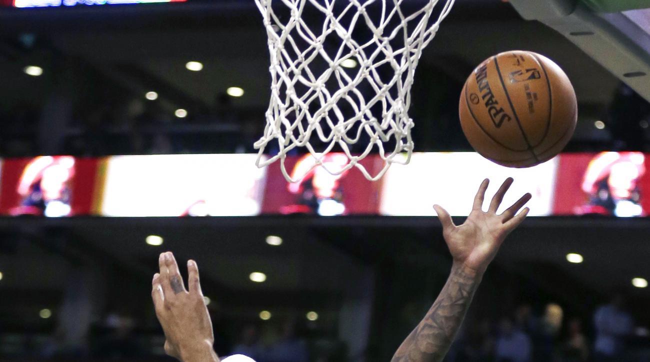 Boston Celtics guard Isaiah Thomas (4) drives to the basket against Atlanta Hawks guard Thabo Sefolosha (25) during the first quarter of an NBA basketball game in Boston, Friday, Nov. 13, 2015. Thomas scored 23 points in the Celtics' 106-93 win. (AP Photo