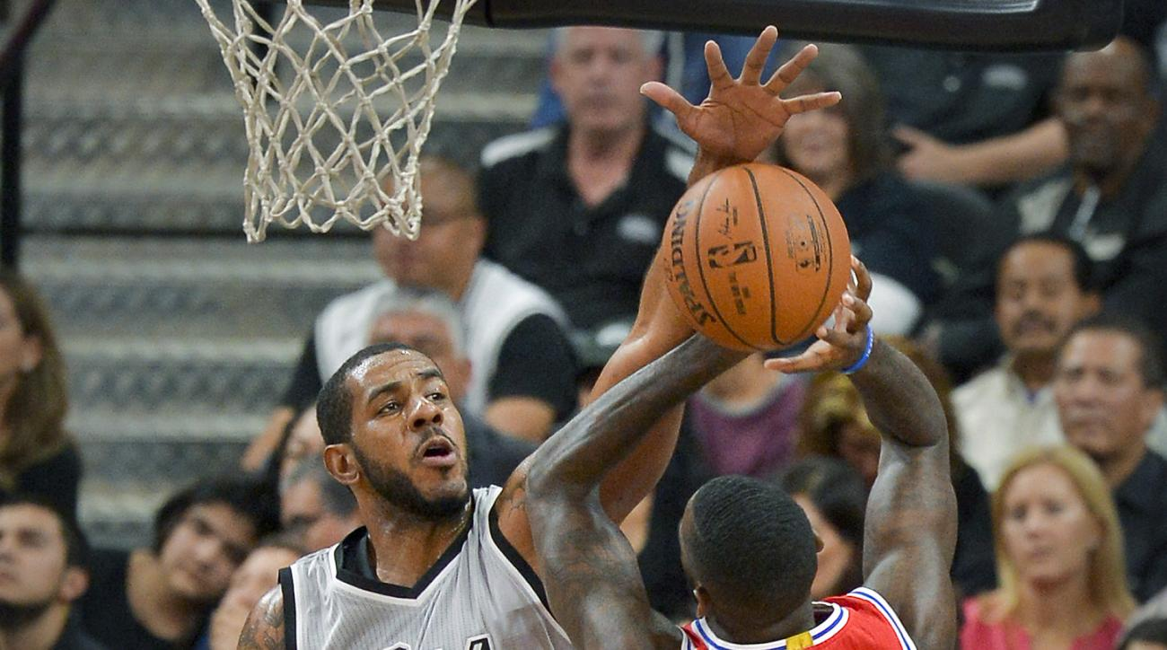 San Antonio Spurs forward LaMarcus Aldridge, left, defends Philadelphia 76ers forward JaKarr Sampson,right,  during the first half of an NBA basketball game, Saturday, Nov. 14, 2015, in San Antonio. (AP Photo/Darren Abate)