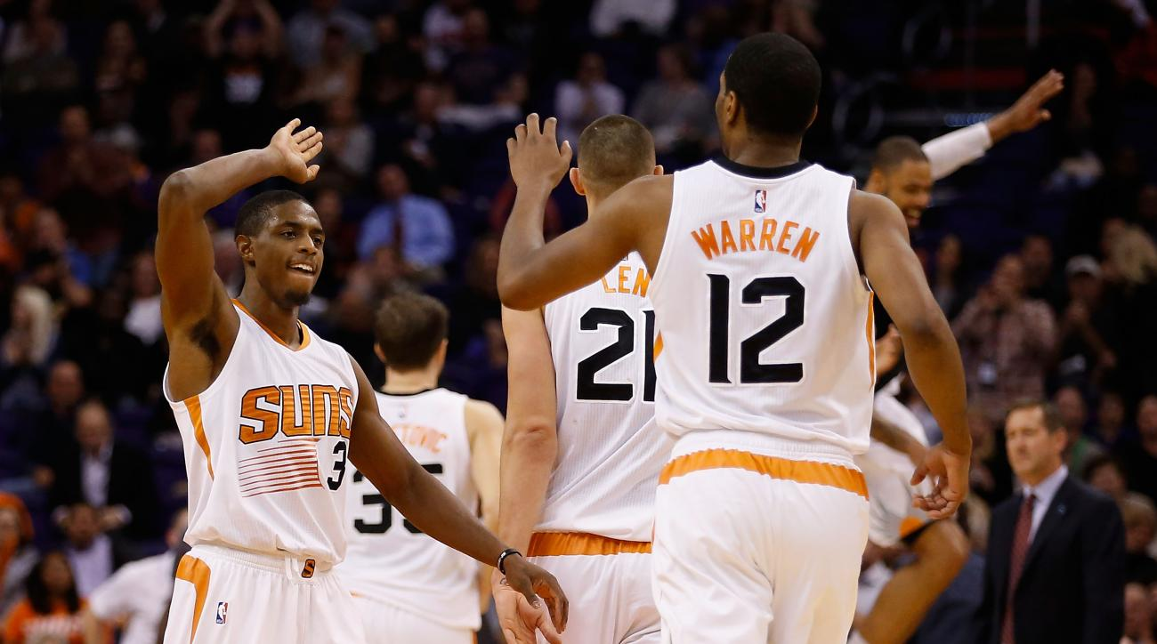PHOENIX, AZ - NOVEMBER 16:  Brandon Knight #3 of the Phoenix Suns high fives T.J. Warren #12 after scoring against the Los Angeles Lakers during the second half of the NBA game at Talking Stick Resort Arena on November 16, 2015 in Phoenix, Arizona. (Photo