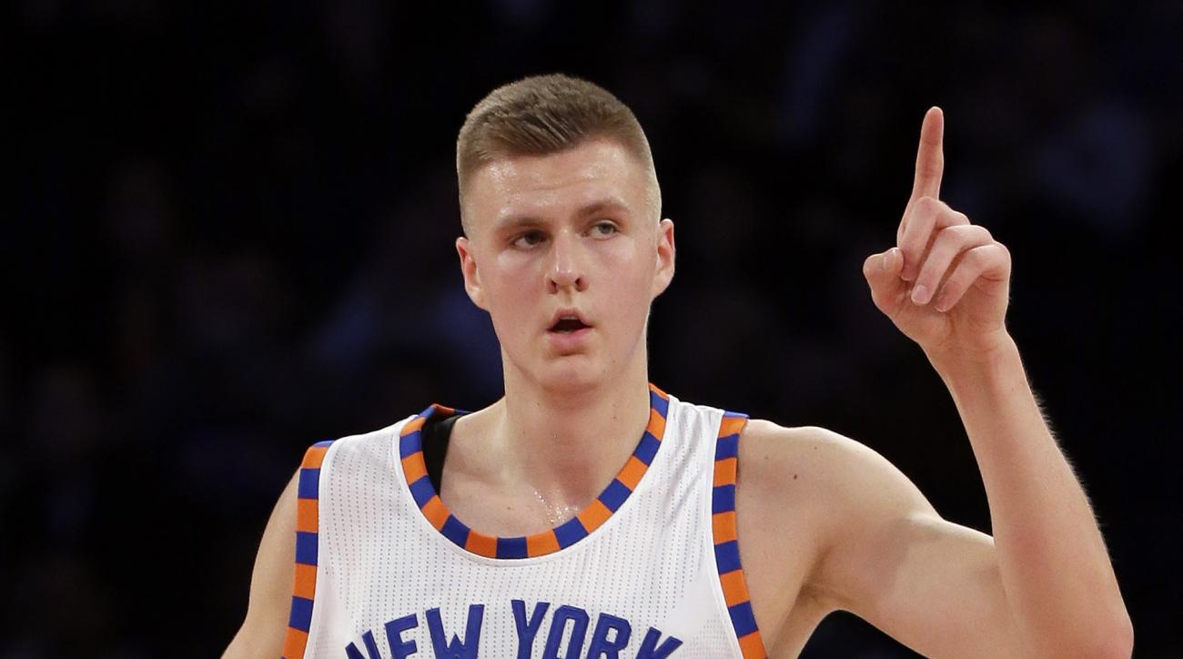 New York Knicks forward Kristaps Porzingis (6) gestures after scoring against the Charlotte Hornets during the first quarter of an NBA basketball game, Tuesday, Nov. 17, 2015, in New York. (AP Photo/Julie Jacobson)