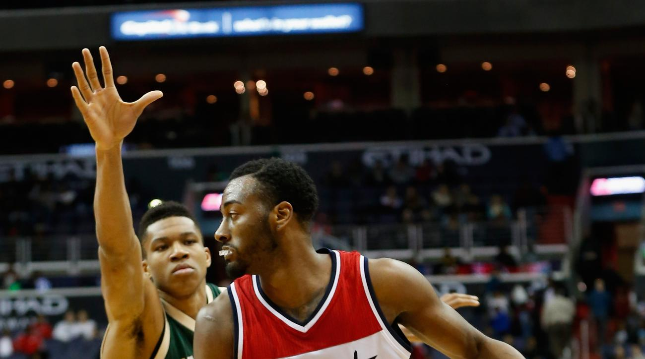 WASHINGTON, DC - NOVEMBER 17: John Wall #2 of the Washington Wizards dribbles around Giannis Antetokounmpo #34 of the Milwaukee Bucks  in the second half at Verizon Center on November 17, 2015 in Washington, DC. (Photo by Rob Carr/Getty Images)