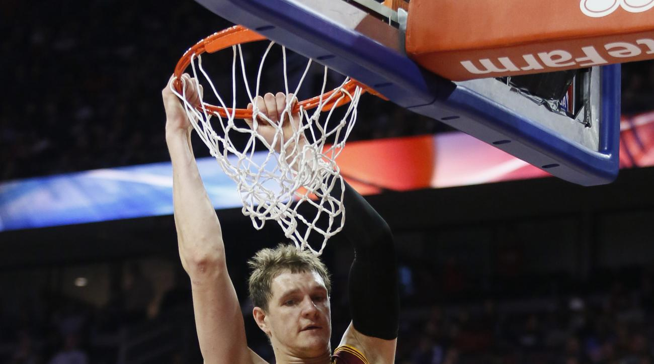 Cleveland Cavaliers' Timofey Mozgov (20) dunks against the Detroit Pistons during the second half of an NBA basketball game Tuesday, Nov. 17, 2015, in Auburn Hills, Mich. The Pistons defeated the Cavaliers 104-99. (AP Photo/Duane Burleson)
