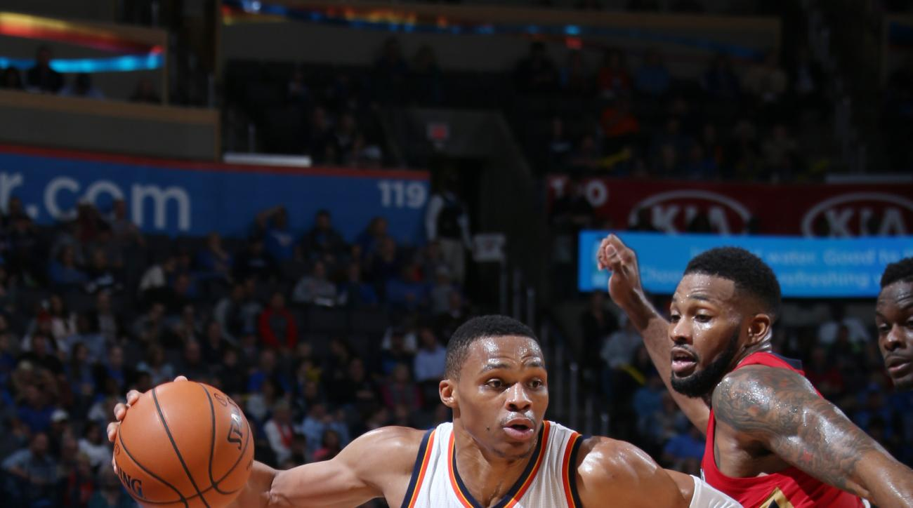 OKLAHOMA CITY, OK - NOVEMBER 18: Russell Westbrook #0 of the Oklahoma City Thunder drives to the basket against the New Orleans Pelicans during the game on November 18, 2015 at Chesapeake Energy Arena in Oklahoma City, Oklahoma . (Photo by Layne Murdoch J