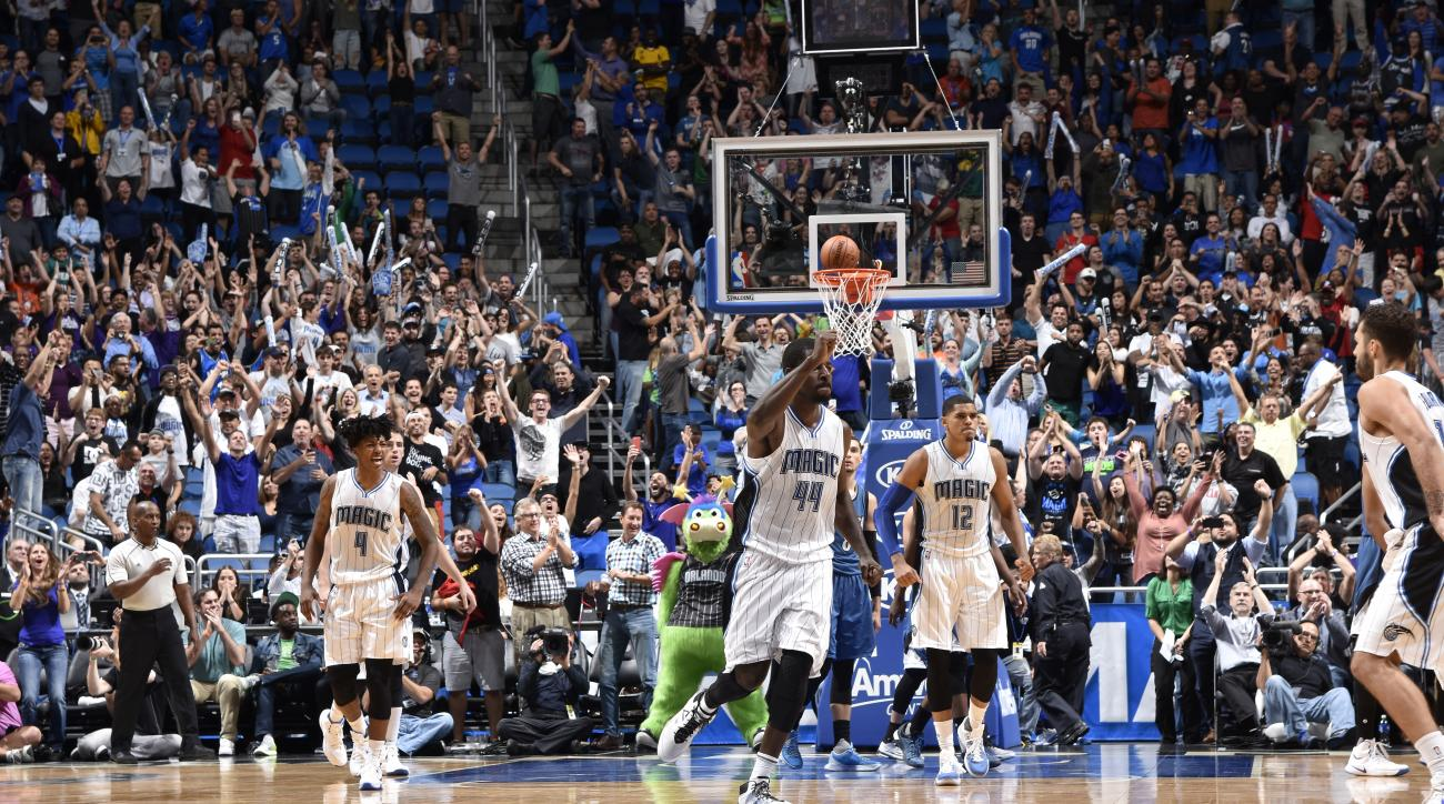 ORLANDO, FL - NOVEMBER 18:  Evan Fournier #10 of the Orlando Magic celebrates with his teammates after hitting the game winning shot against the Minnesota Timberwolves on November 18, 2015 at Amway Center in Orlando, Florida. (Photo by Fernando Medina/NBA